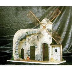 Molino con movimiento, formado por una torre circular y un pequeño caserio adosado y un arco.