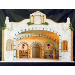 Edificio con gran estancia interior, decorado con 6 columnas salomonicas y 2 estanterias con papiros y utensilios para la escrit