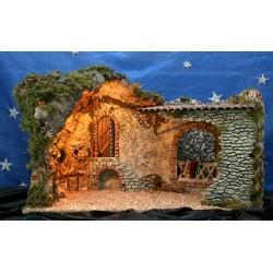 Cueva con luz, realizada en corcho bornizo y alabastro, con una estancia interior amplia y decoracion rustica.