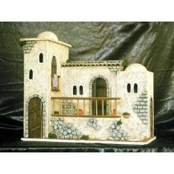 Posada con varias casitas adosadas y terraza central a la cual se accede por una escalera lateral.