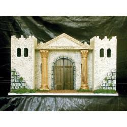 Palacio con dos torres laterales y una parte central con una puerta y dos columnas corintias soportando un fronton triangular.