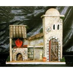 Casa con fogon lateral y pequeño porche central.