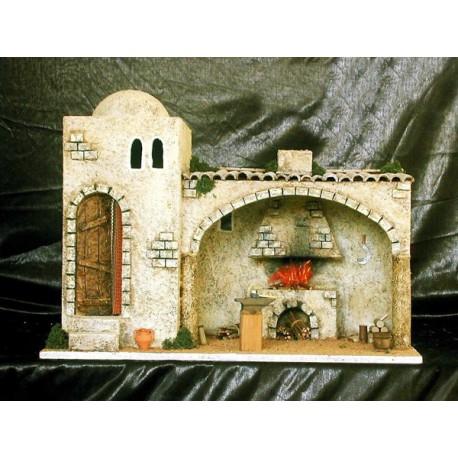 Herrería con estancia interior fogon con chimenea y puerta lateral.