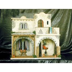 Casa con dos estancias interiores una con un fogon y chimenea, y una superior con terraza.