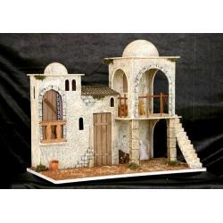 Grupo de dos casas y un pajar con dos estancias una superior con una escalera y una inferior.