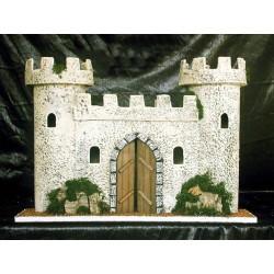 Castillo con dos torres laterales y puerta central.